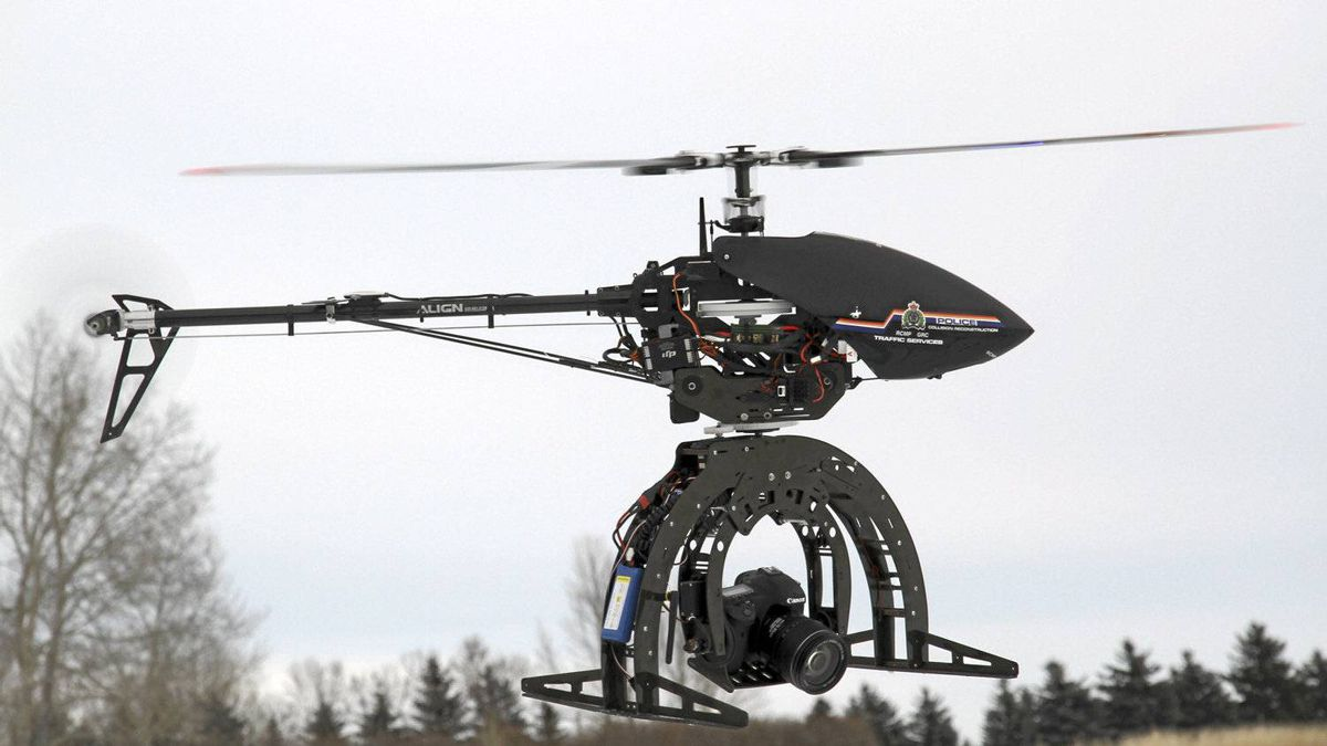 A TREX 500 Helicopter made by Align is an electric helicopter with a camera mounted to its wide base.