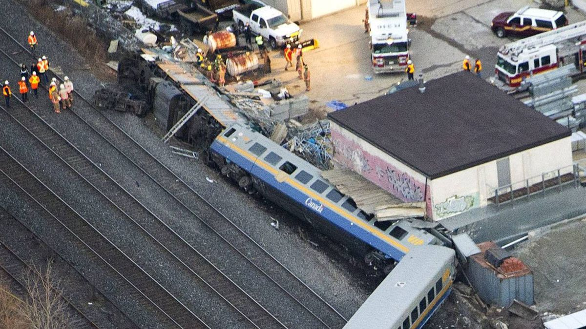Emergency crews attend the scene of a VIA Rail train derailment in Burlington, Ont., on Feb. 26, 2012. Nathan Denette/The Canadian Press