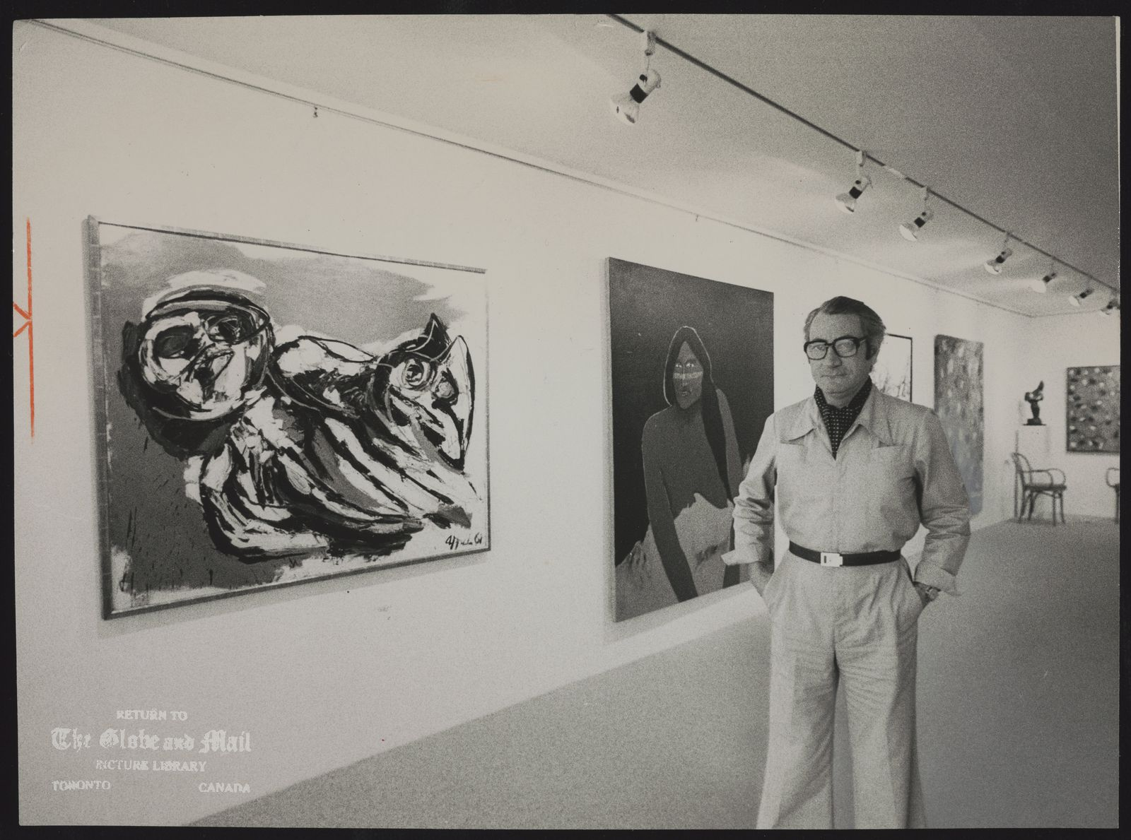 MOOS GALLERY Walter Moos savors hs 2600 square feet, flanked to the left by Karel Appel's Chinese Woman and Cat.