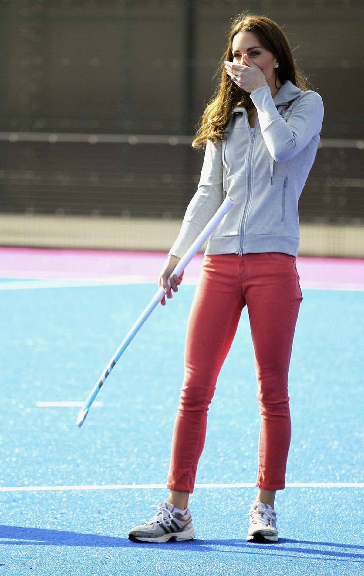 To promote the approaching Olympics, Kate plays field hockey in London's Olympic Park on March 15 while sporting a Team GB sweatshirt and on-trend skinny coral jeans by J. Brand.