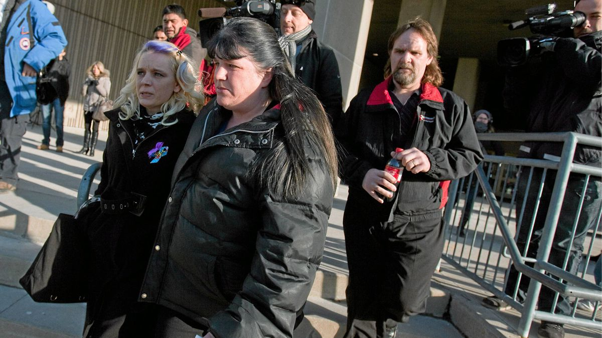 Prosecution witness Laura Perry, right, leaves court following her testimony in the Michael Rafferty murder trial in London, Ontario on March 6, 2012.
