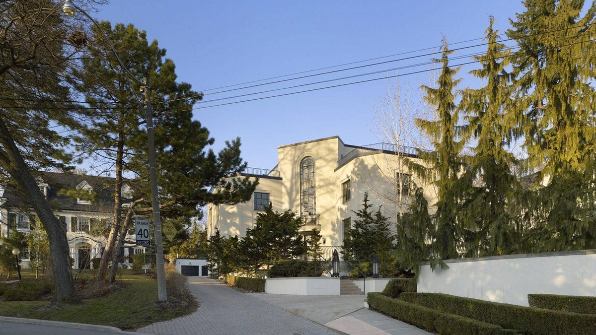 """The Lawren Harris house in Toronto. '[The owners] were not interested in having us mess with the front of the house,"""" says renovating architect Drew Mandel. """"We thought our renovation actually mirrored the evolution of the house since it was built,' he says, 'because the formal rooms were all intact and in good shape, but the things that didn't reflect how we live now - the family room, the kitchen where you had these little punched windows for someone to go disappear and make food and come out - turned it into a standard renovation project.'"""