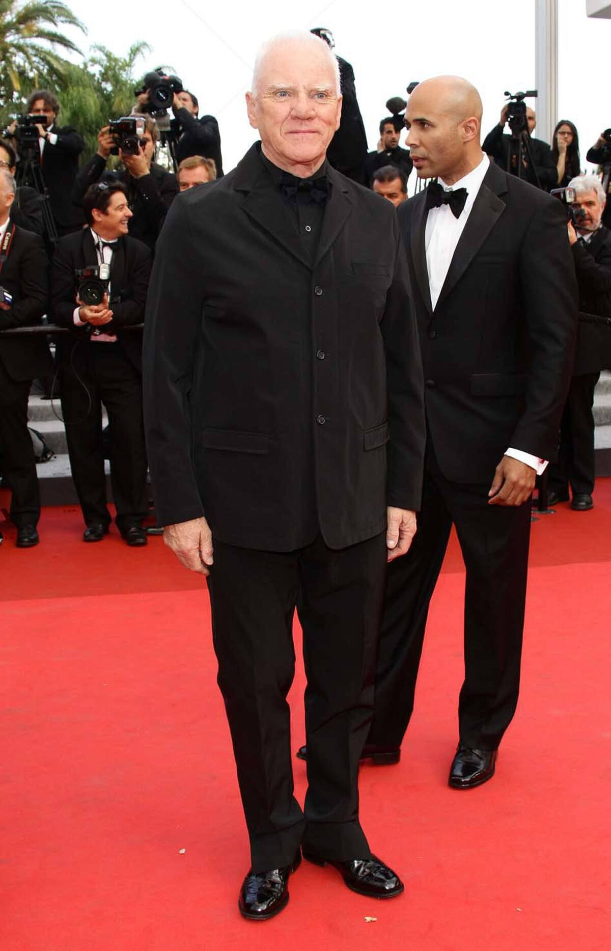 """Malcolm McDowell attends the """"The Skin I Live In"""" premiere at the Cannes Film Festival on Thursday."""