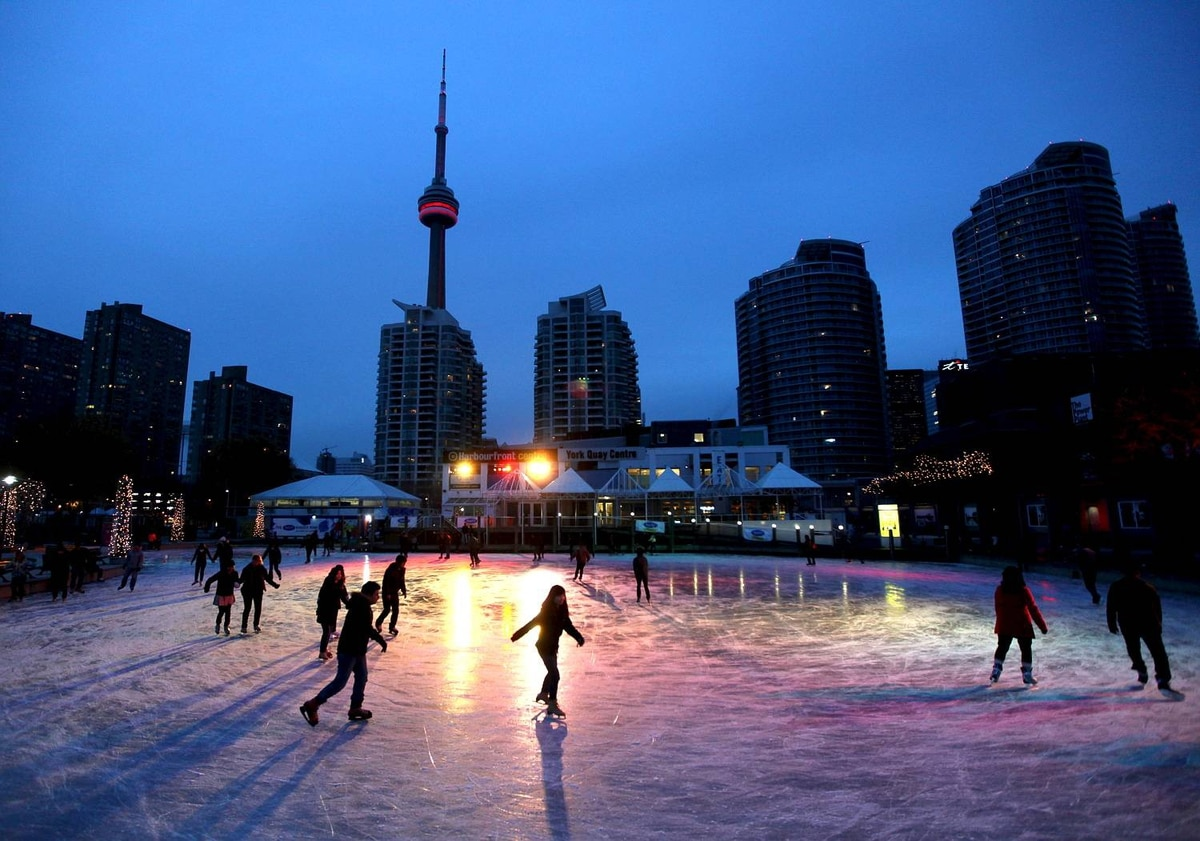 Skaters make their way around the Natrel Rink at the Harbourfront Centre along Toronto's waterfront.