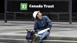 A construction worker sits in front of TD Canada-Trust Head office in Toronto, May 26, 2011.