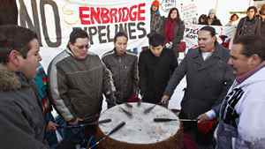 Traditional drummers Thundering Spirit take part in a rally outside the Enbridge Northern Gateway oil sands pipeline project hearings at the Wingate hotel in Edmonton on Jan. 23, 2012.