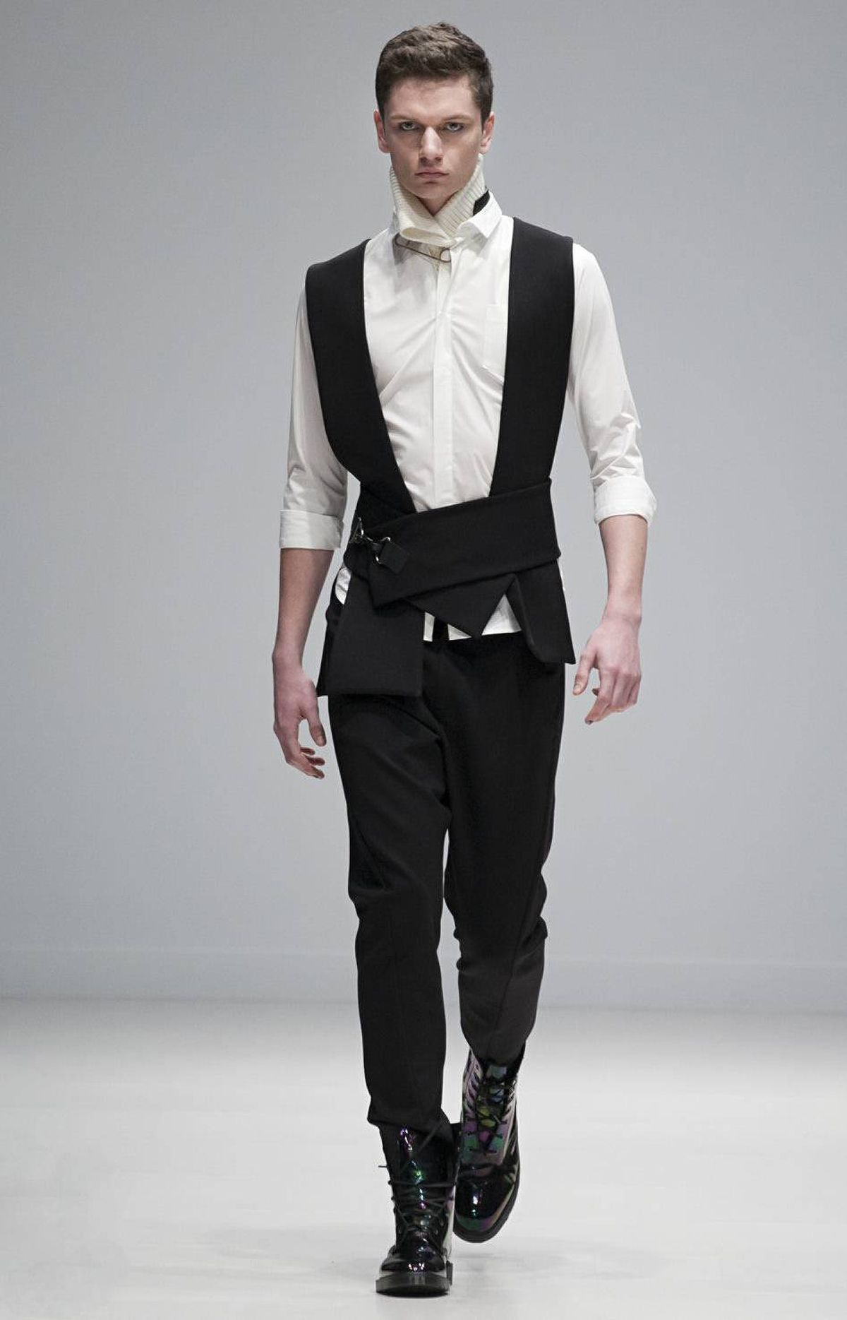 Previously shown alongside its sister label Greta Constantine, Kirk Pickersgill and Stephen Wong presented a men's wear collection that held its ground. Focusing on the idea of armour and protection, the line incorporated boiled wool, heavy knit sweaters and light touches of bondage alongside their signature draped cottons.