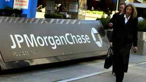Pedestrians walk past the JP Morgan Chase headquarters in New York.