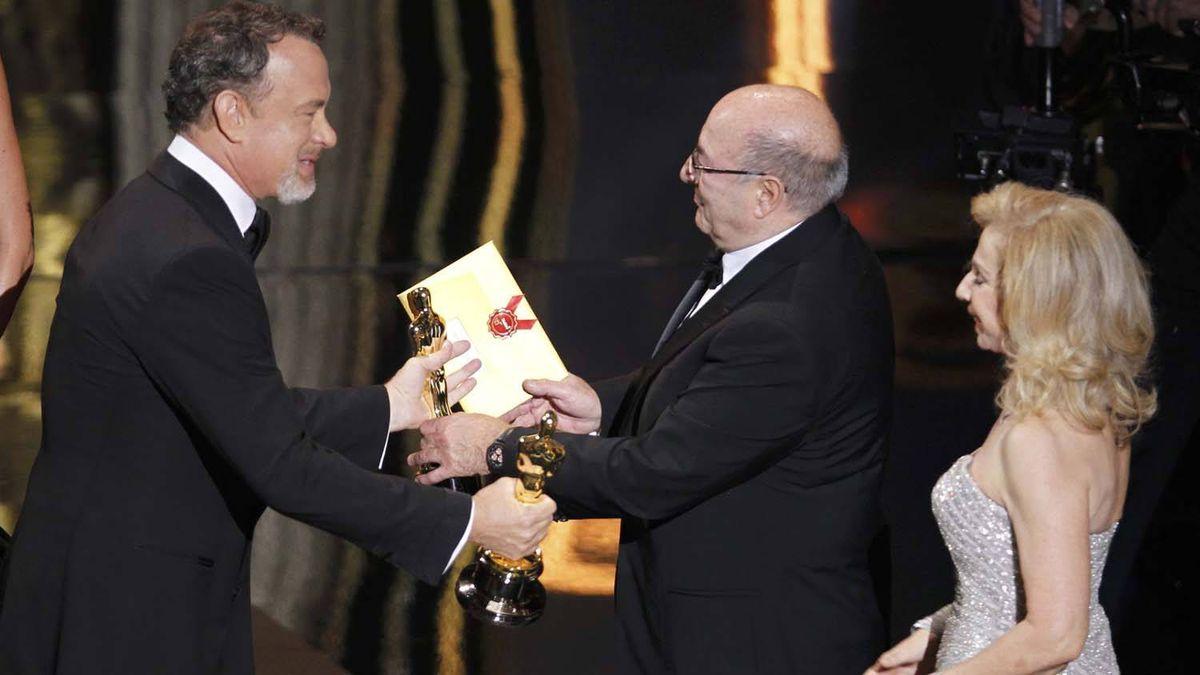 "Actor Tom Hanks (left) presents the Oscar for the Best Art Direction for the work in the film ""Hugo"" to Italian designer Dante Ferretti and set decorator Francesca Lo Schiavo."