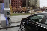 A Chevrolet Volt electric vehicle plugged into a charging station in front of General Motors world headquarters in Detroit, Michigan November 18, 2010.