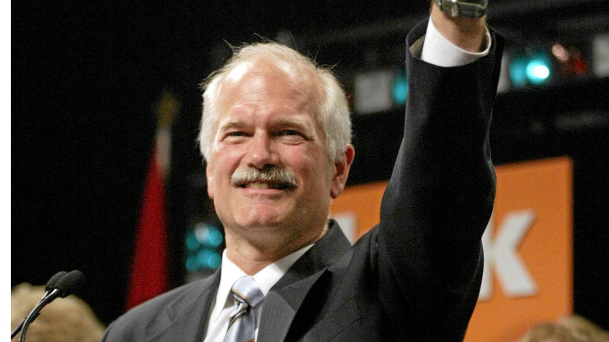 Federal NDP Leader Jack Layton waves to the crowd after Layton's victory in the federal election in Toronto on Monday, June 28, 2004.