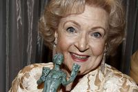 """Betty White with her award for outstanding performance by a female actor in a comedy series for """"Hot in Cleveland"""" at the 18th Annual Screen Actors Guild Awards on Sunday Jan. 29, 2012 in Los Angeles."""