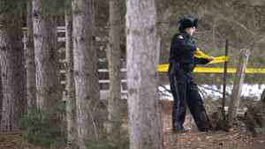 An OPP officer tapes off property belonging to Colonel Russell Williams in Tweed, Ont. Ben Nelms for The Globe and Mail