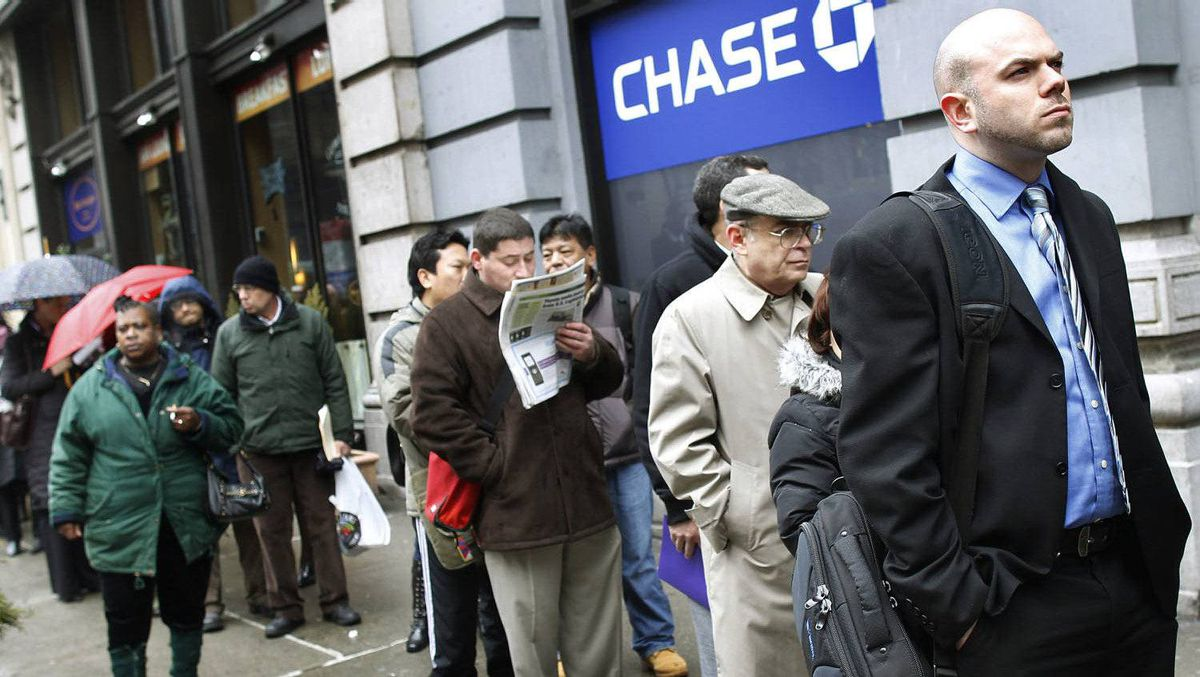 People wait in line to enter the NYCHires Job Fair in New York in this file photo.