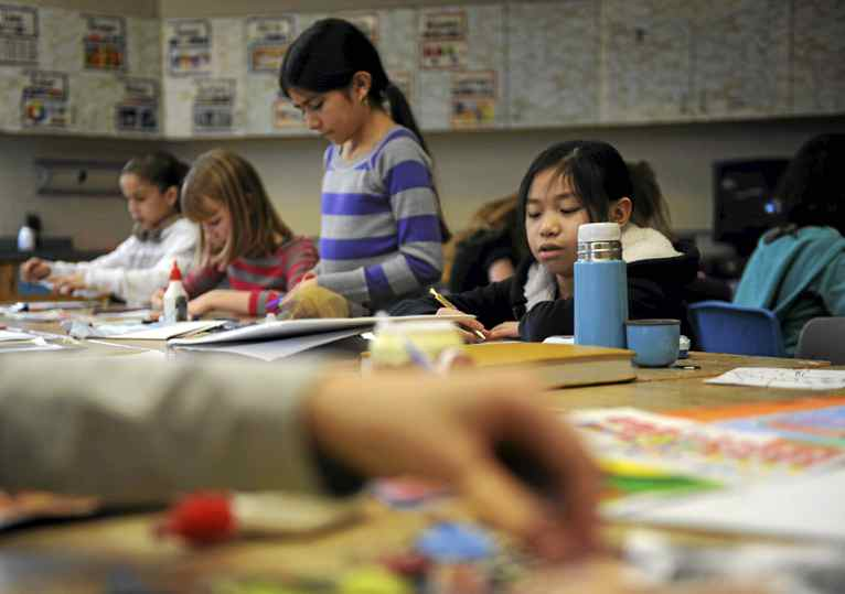 Alison Ng, 10, right, is photographed on Jan 23 2012, during her visual arts class at Baythorn Public School in Thornhill, Ont..