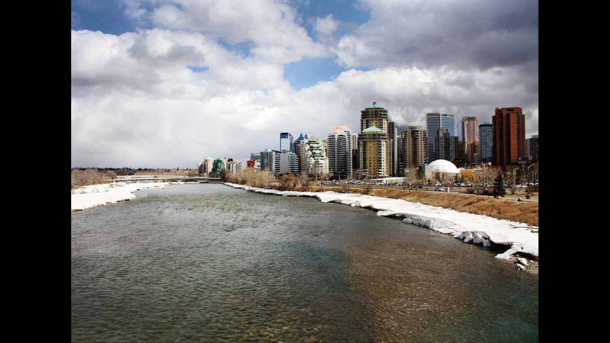 Downtown Calgary is swallowed by the Bow River and the beginnings of threatening rain clouds. Photo taken March 30, 2012