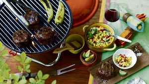 From left: Fox Run barbecue fork, $13.99 at Whole Foods; Bodum Charcoal Grill, $59.99 at Indigo. Williams-Sonoma metal tongs, $30, boar-bristle brush, $15, yellow ceramic bowl with handles, $76, green jacquard tablecloth, $42.90, napkin rings, $16 for set of four, cedar grilling plank, $7.57, seashell salt and pepper dishes with spoons, $10. Striped Tag napkins, $16.99 for set of three, coloured measuring cups, $14.99 for set of four at Whole Foods.
