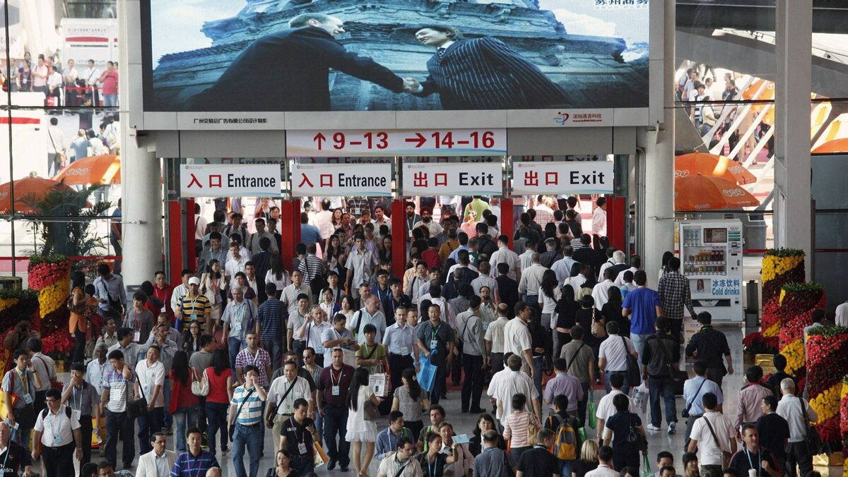 Visitors walk through an entrance to China Import and Export Fair, also known as the Canton Fair, in the southern Chinese city of Guangzhou October 17, 2011. Exporters at China's largest trade show, the Canton Fair, say a darkening economic outlook in Europe and the United States is weighing on orders for Chinese-made goods from Western buyers, potentially boding ill for China's growth prospects.