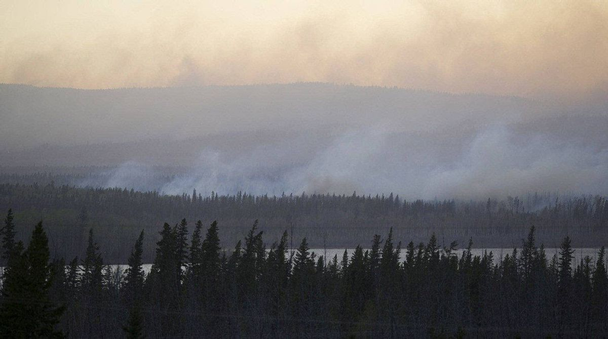 Smoke rises off of massive wildfires near Slave Lake, in northern Alberta, on May 15, 2011.