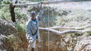A child miner returns to the surface at dawn after working all night in a shaft dug by hand.