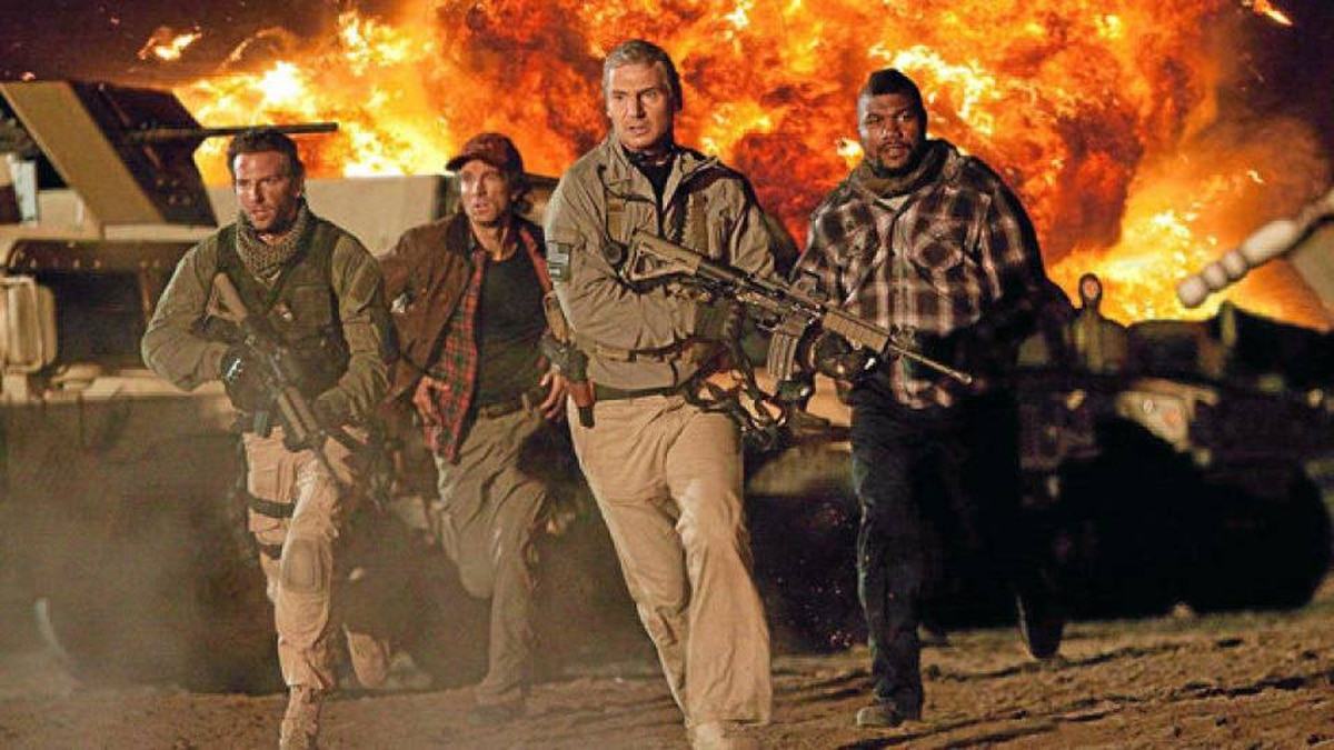 """The A-Team in action: (from left) Face (Bradley Cooper), Murdock (Sharlto Copley), Hannibal (Liam Neeson) and B.A. (Quinton """"Rampage"""" Jackson)."""