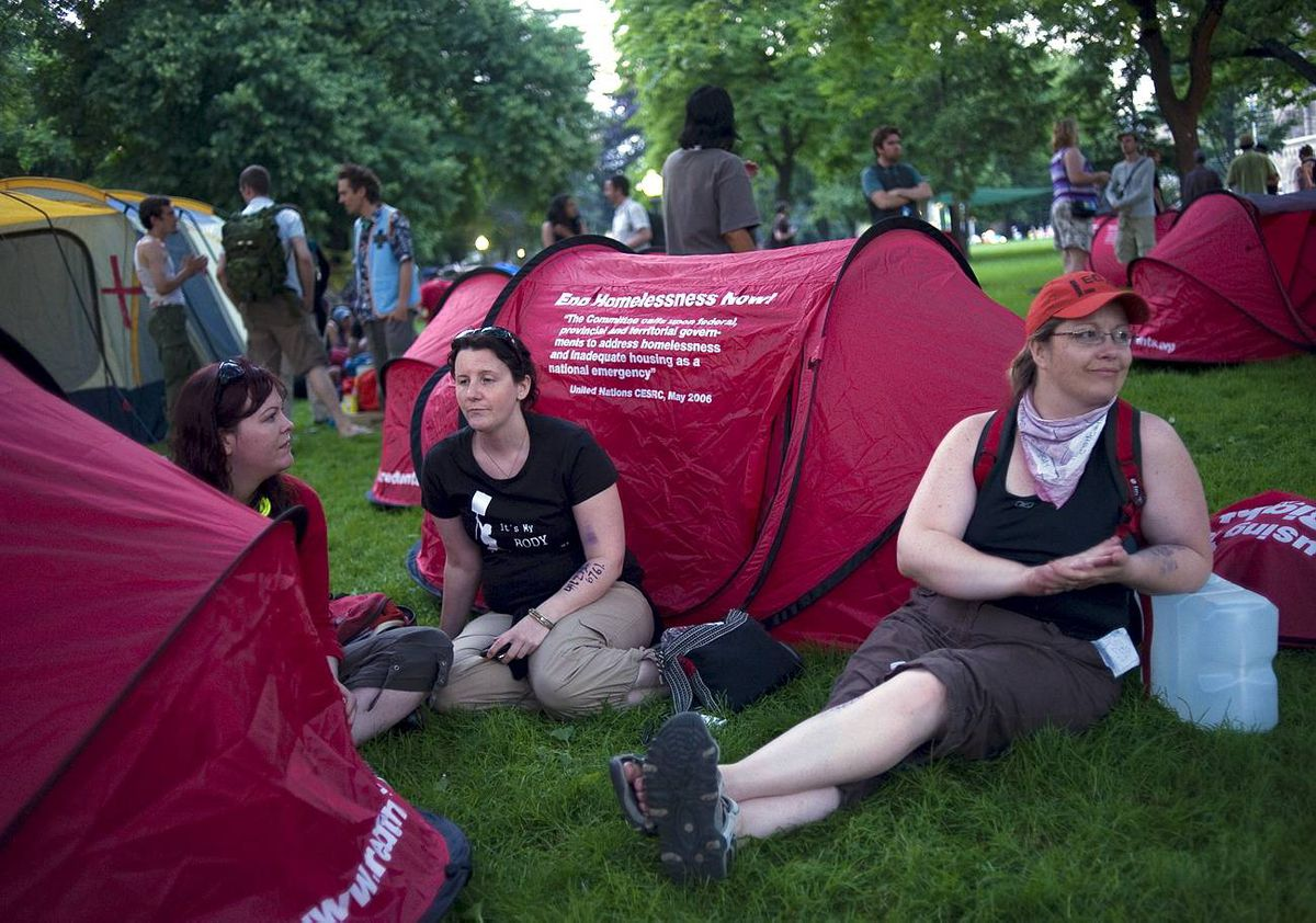 Citizens who marched together in protest of the G8/G20 summits, through downtown Toronto, erect a tent city in Allan Gardens and begin to rest and unwind.