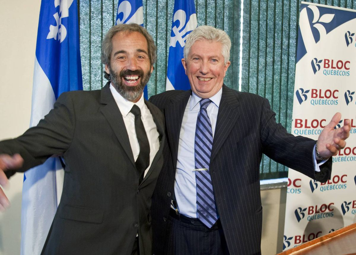 Bloc Quebecois Leader Gilles Duceppe hams it up with star recruit Daniel Paille at a press conference in Montreal on Sept. 4, 2009 .
