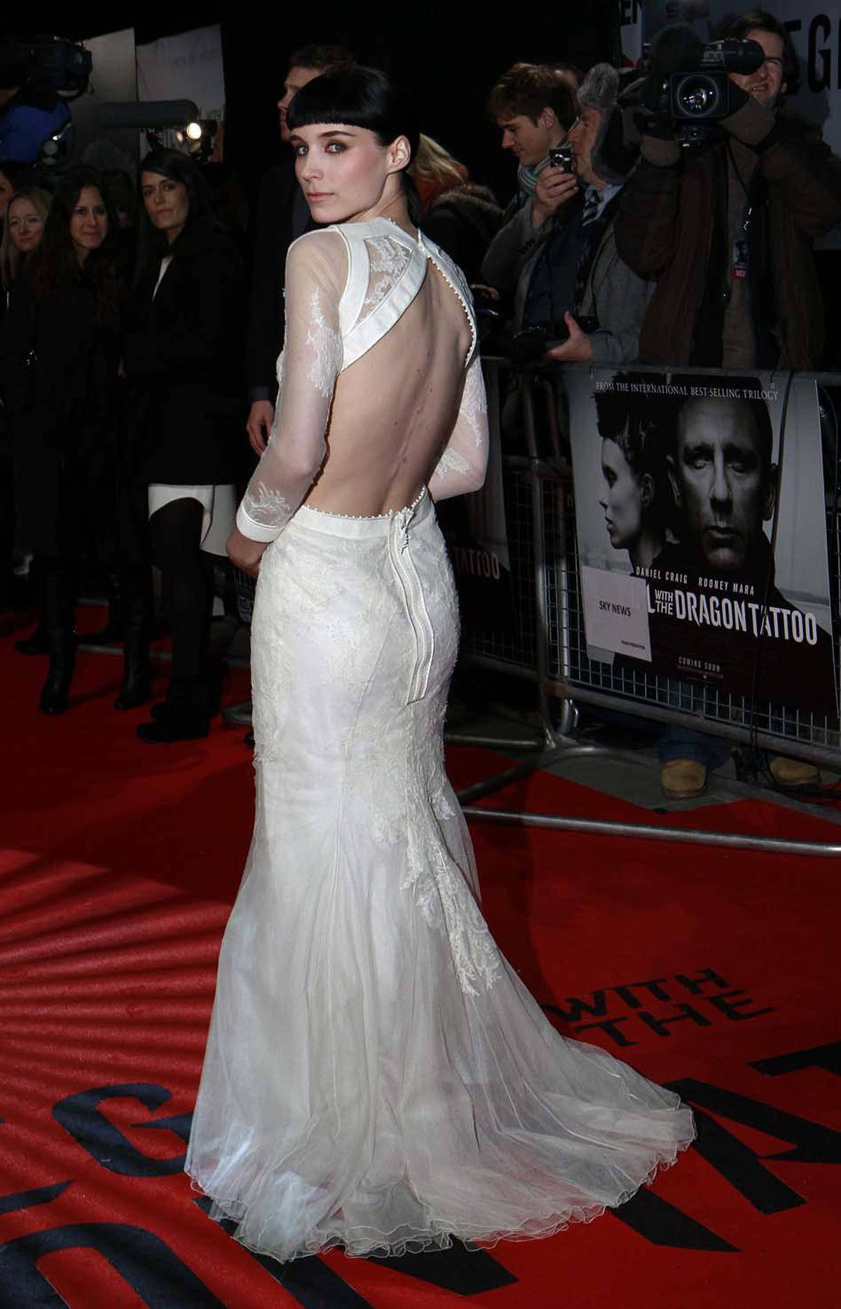 "Actress Rooney Mara throws a completely spontaneous look over the shoulder of her perfectly flowing gown at the world premiere of ""The Girl with the Dragon Tattoo"" in London on Monday."