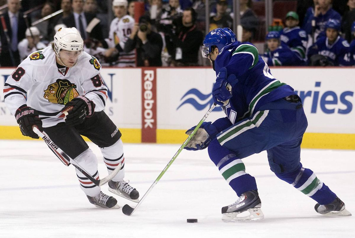 Patrick Kane #88 of the Chicago Blackhawks tries to get past Nolan BaumGartner #44 of the Vancouver Canucks during the first period of NHL action on January 23, 2010 at General Motors Place in Vancouver, British Columbia, Canada. (Photo by Rich Lam/Getty Images)