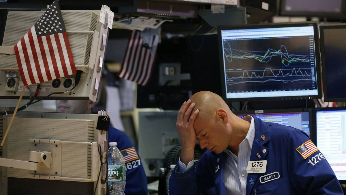 Trader Mario Picone works on the floor of the New York Stock Exchange in this June 1, 2012 file photo.