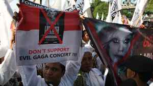 Muslim men hold up banners during a rally against U.S. pop singer Lady Gaga on Friday, May 25, 2012 in Jakarta, Indonesia.