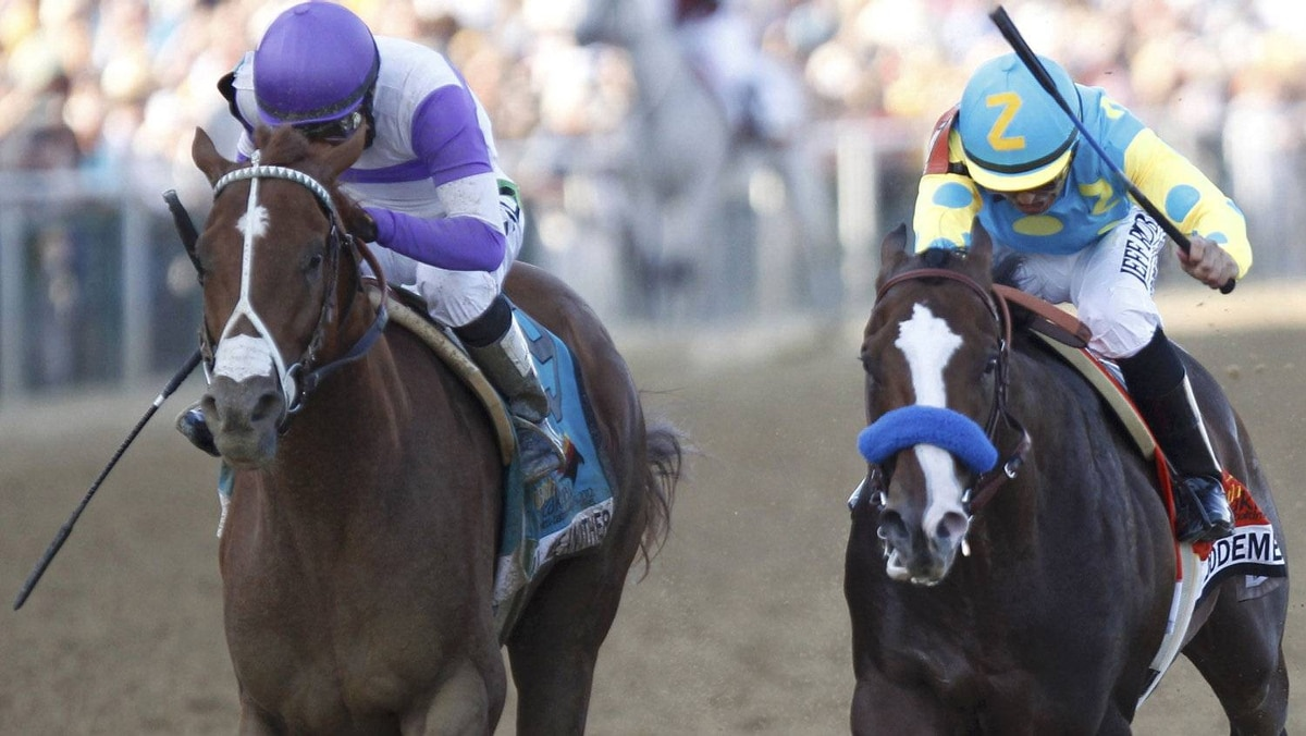 I'll Have Another with jockey Mario Guitierrez in the irons (L) goes past Bodemeister with jockey Mike Smith in the irons to win the 137th running of the Preakness Stakes at Pimlico Race Course in Baltimore, Maryland, May 19, 2012. REUTERS/Mike Segar