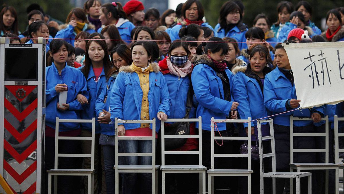 Workers on strike block the entrance gate of Hi-P International factory in suburban Shanghai, the latest outbreak of labour unrest in China.