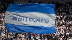 A giant Vancouver Whitecaps flag flies in the stands during the first half of an MLS soccer game against the Vancouver Whitecaps FC and the Toronto FC in Vancouver, March 19, 2011.