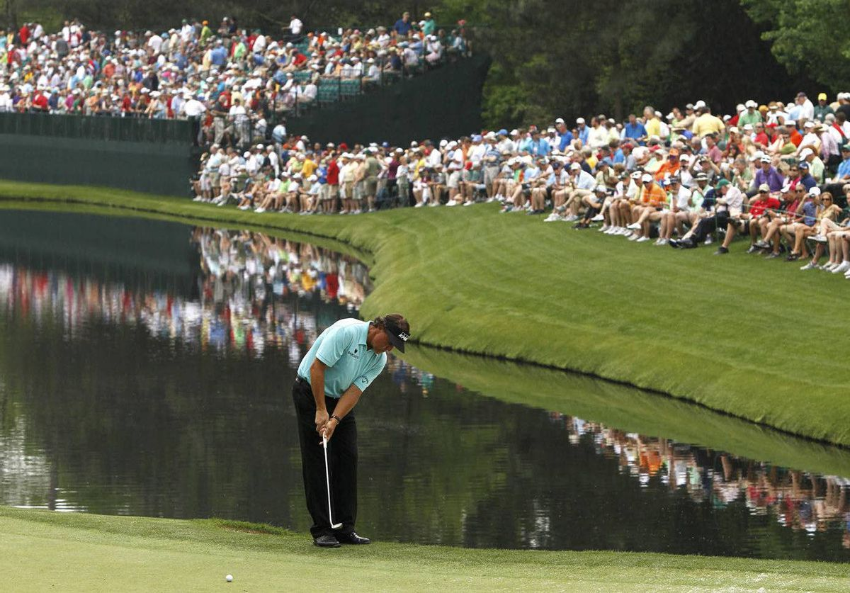 Phil Mickelson of the U.S. putts on the 16th green during a practice round for the 2012 Masters Golf Tournament at the Augusta National Golf Club in Augusta, Georgia.