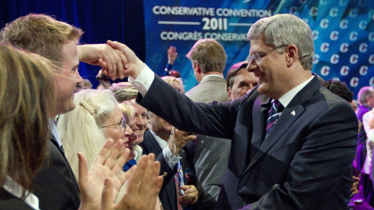 Prime Minister Stephen Harper is greeted by supporters after his keynote address to the Conservative convention in Ottawa, Friday June 10, 2011.