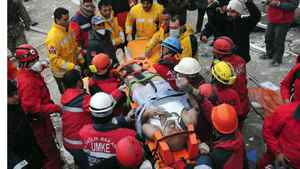 Rescue workers carry earthquake survivor Mehmet Zengin to an ambulance after he was found in a collapsed building in Van, eastern Turkey November 10, 2011. Rescue workers searched for survivors under rubble in eastern Turkey Thursday after the second earthquake in three weeks killed at least seven people, inflating the death toll of 600 from the previous tremor.