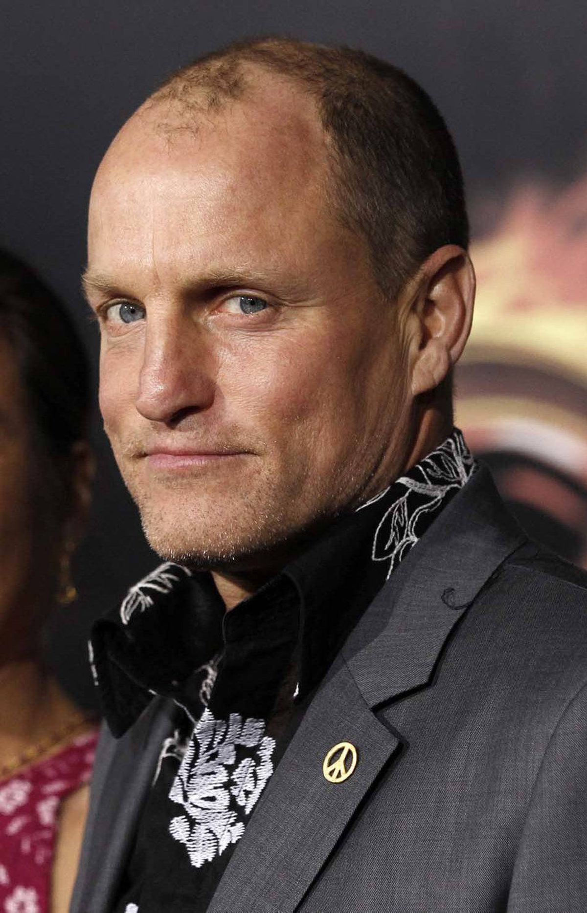 """That's enough with the gratuitous Leven Rambin photos,"" Woody Harrelson declares at the world premiere of ""The Hunger Games"" in Los Angeles on Monday."