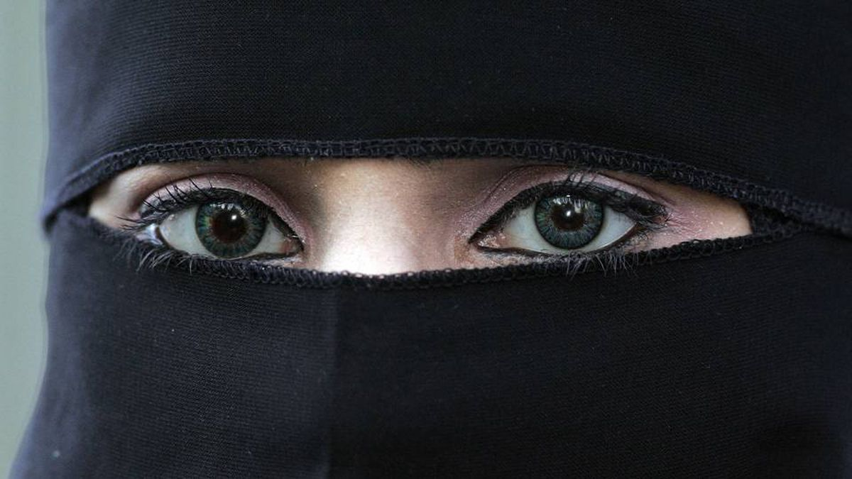 A 2006 file photo of a woman wearing a niqab in Blackburn, England. Quebec's move to require removal of the veil to receive public services is likely unconstitutional, legal experts say.