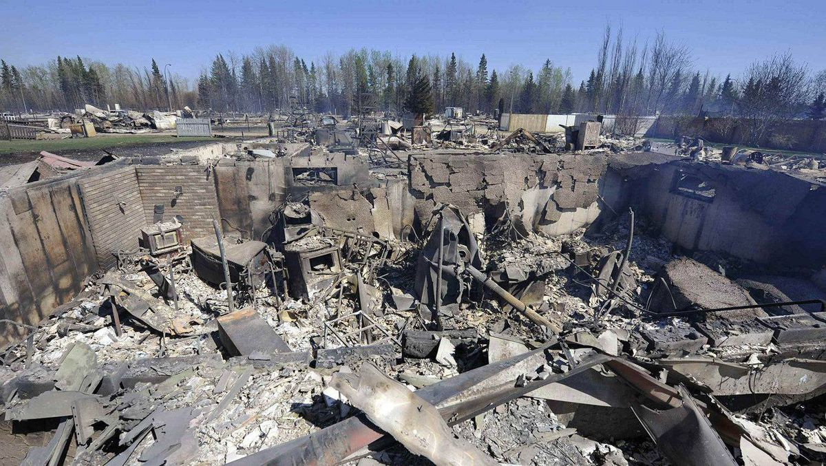The foundation of a house that has been burned down, sits in a completely destroyed neighborhood of Slave Lake, Alberta May 16, 2011.