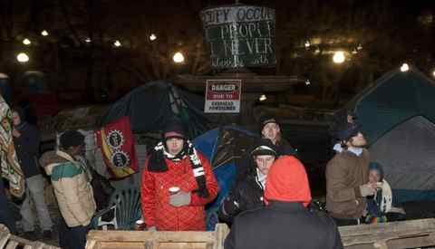 Demonstrators form a wooden barricade around a fountain at the Occupy protest site as the midnight deadline to take down the camp has passed in Ottawa early Tuesday morning November 22 2011.