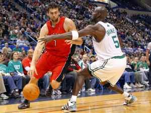 Toronto Raptors centre Andrea Bargnani, left, drives to the basket around Boston Celtics forward Kevin Garnett in the first quarter of their NBA preseason basketball game in Hartford, Connecticut, October 14, 2009.