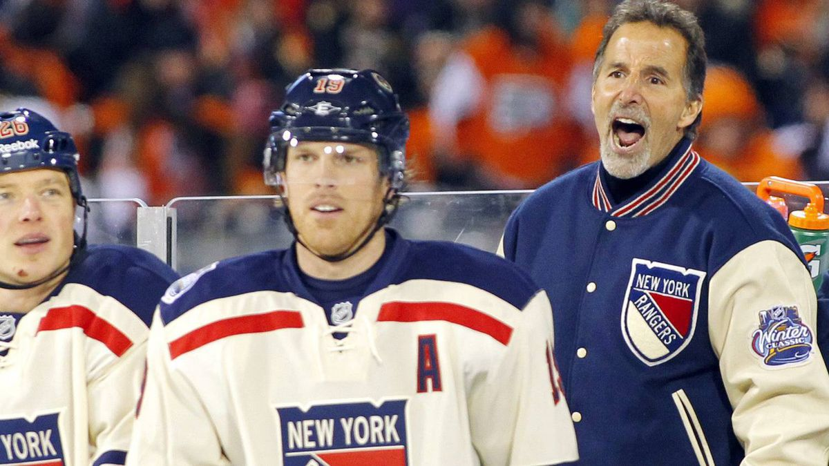 New York Rangers coach John Tortorella, right, argues a penalty call as Ruslan Fedotenko, left, of Ukraine, and Brad Richards look on late in the third period of the NHL Winter Classic hockey game against the Philadelphia Flyers, Monday, Jan. 2, 2012, in Philadelphia. New York won 3-2. (AP Photo/Tom Mihalek)