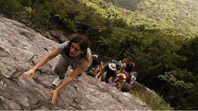 Rock climbing in the Caribbean National Rain Forest, commonly called El Yunque, near Naguabo, Puerto Rico.