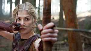 """Andromeda (played by Rosemund Pike) strains her bowstring in a scene from """"Wrath of the Titans."""""""