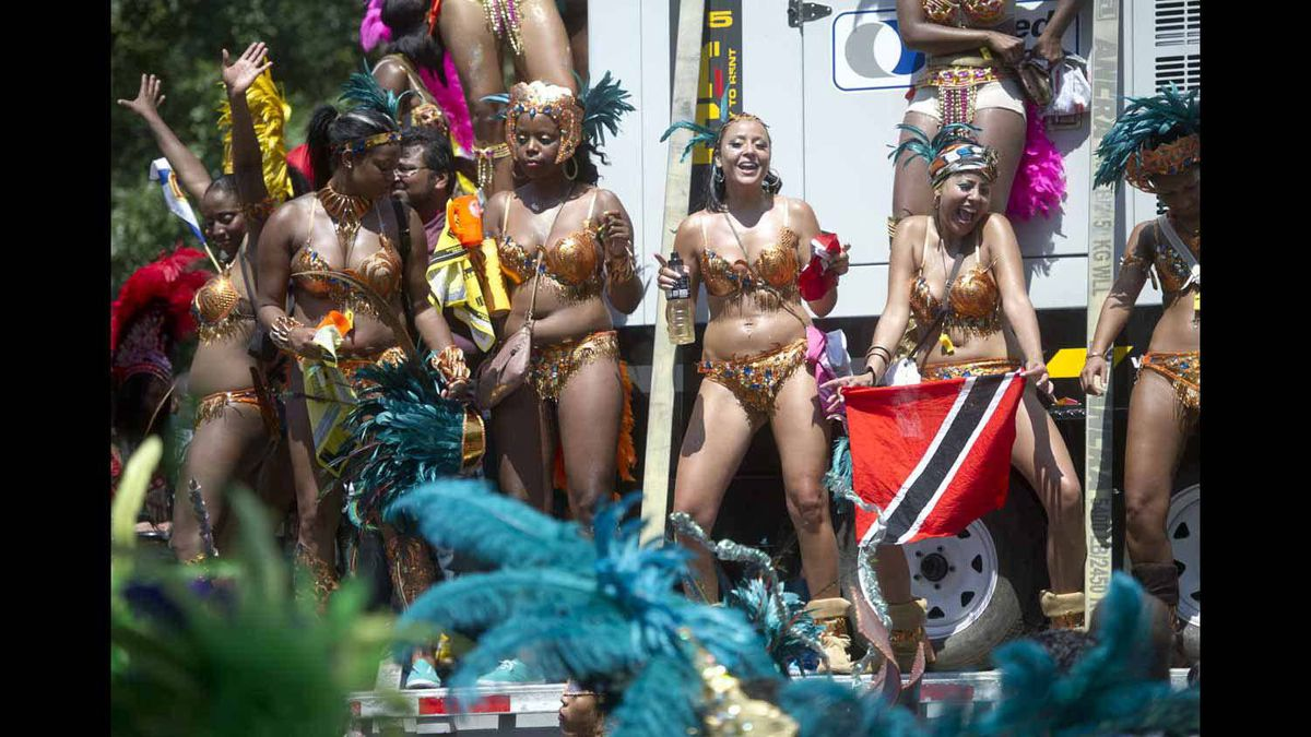 Dancers party on the Caribbean Carnival parade.