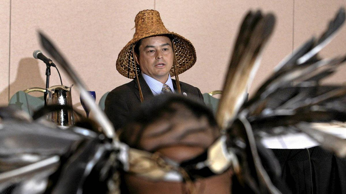 National Chief Shawn Atleo as seen through ceremonial eagle feathers, speaks at a news conference in Vancouver, BC, June 24, 2010. Leaders of both the Sto:lo and Chehalis First Nations held the news conference to address significant issues arising from a trail of First Nations citizens charged with illegally trafficing in Bald eagle parts.