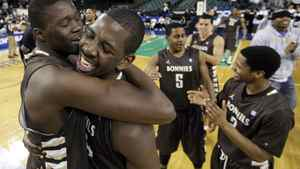 St. Bonaventure players Youssou Ndoye, left, of Senegal, and Canadian Andrew Nicholson celebrate after defeating Xavier 67-56 to win the NCAA college basketball championship game in the Atlantic 10 men's tournament in Atlantic City, N.J., March 11, 2012.
