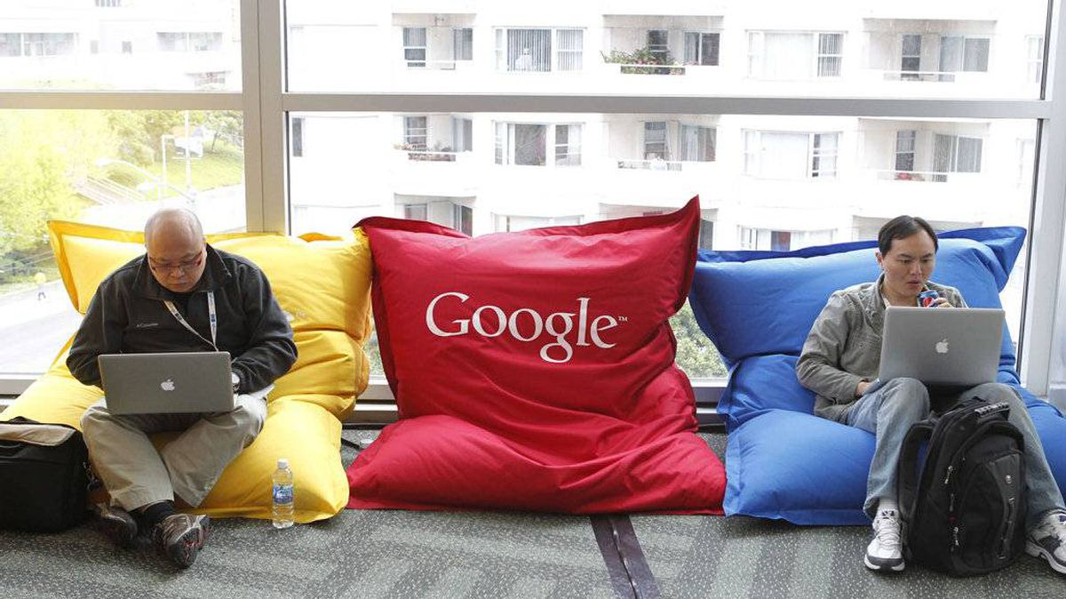 Attendees Dominie Liang (L) and Ruslan Belkin utilize the common area at the Google I/O Developers Conference in the Moscone Center in San Francisco, California, May 11, 2011.