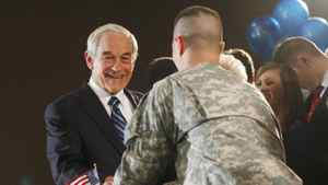 Republican presidential candidate Ron Paul shakes hands with Corporal Jesse Thorsen at a rally in Ankeny, Iowa, on Jan. 3, 2012.